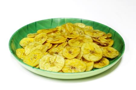 白で隔離バナナ チップ 写真素材