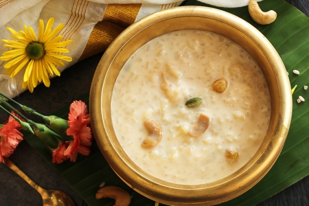 Rice Kheer  Paal (Pal) Payasam served in Traditional Brass Vessel Stock Photo