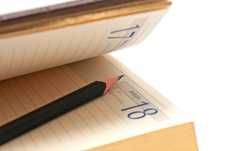 Pencil in an open diary on the white background Stock Photo - 8519647