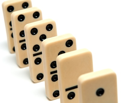 consequence: Chain of dominoes on a white background