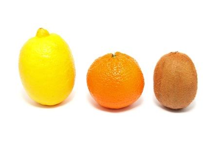 Kiwi, lemon and tangerine on a white background photo