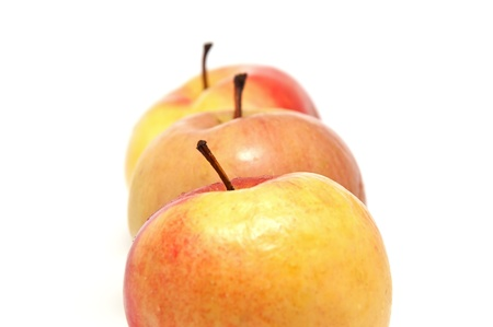 Ripe juicy apples on a white background photo
