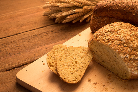 fall harvest: Bread on chopping board and rustic tabletop background Stock Photo
