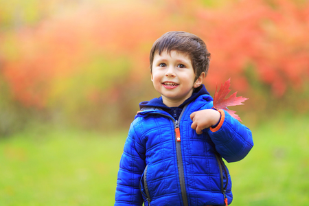 Boy with a red maple leaf attached in the heart region with great pride as Canadian citizen.
