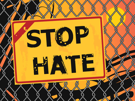 hate: Text Stop Hate written with grunge letters on a broken wire fence