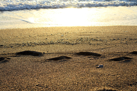 Footstep on the Beach, Sand and Beautiful Sunset in the Sea