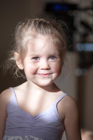 Little girl in the rays of sunlight