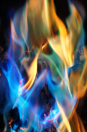 blue flame: Abstract Blue and Orange Flames from a Log Fire Stock Photo