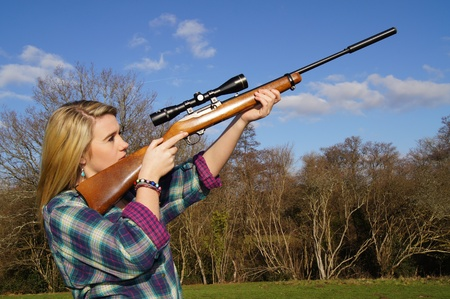 outside shooting: Girl Aiming Her Rifle