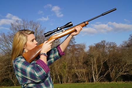 outside shooting: Girl Aiming Her Rifle