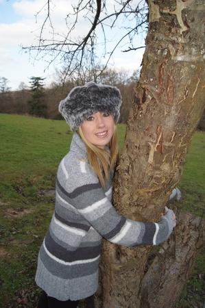 Girl hugging a tree photo