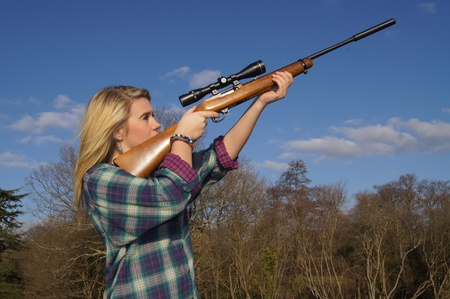 Girl Aiming Her Rifle photo