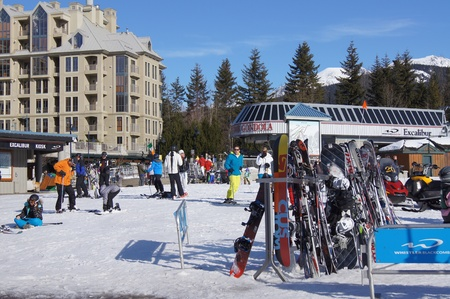 boarders: The bottom of the ski slopes at Whistler, Canada Editorial
