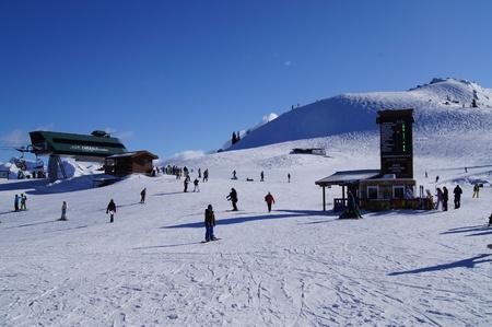 boarders: Chairlift at peak of Whistler ski resort Editorial