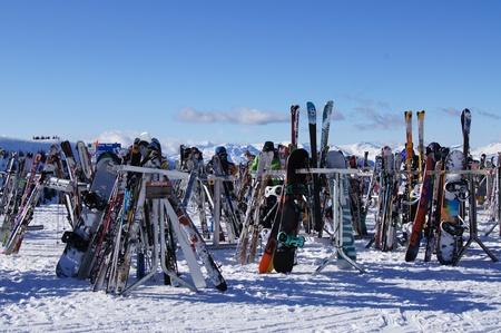 boarders: Skis and Boards laying in racks