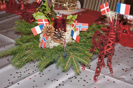 center table: Christmas Table decorated with crackers, flags and reindeer