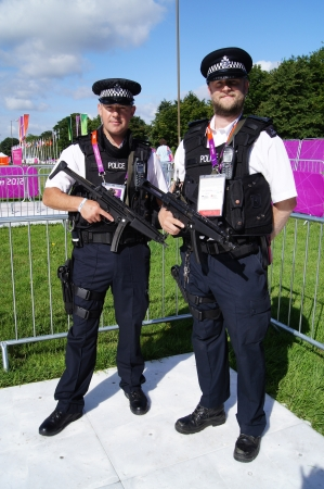 LONDON, ENGLAND. AUGUST 2012. Armed Police Officers on duty at the Olympic Games, Royal Artillery Barracks, London, England on 2nd August 2012
