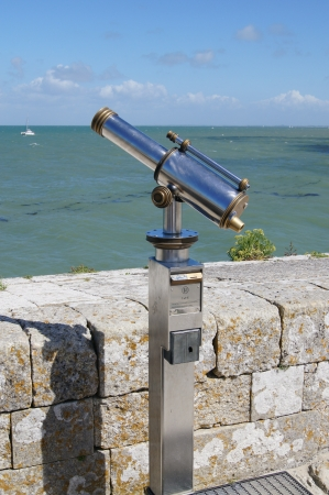 Telescope with view towards the sea photo