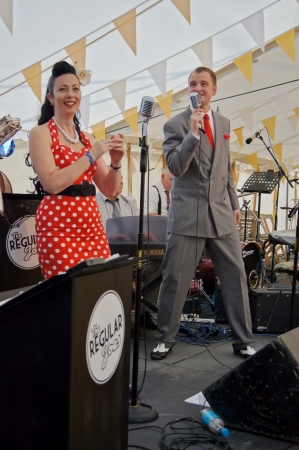 WEST SUSSEX, ENGLAND. SEPTEMBER 2012: Band The Regular Joes singing retro swing music at the Goodwood Revival on 15th September 2012; Goodwood, West Sussex, England.