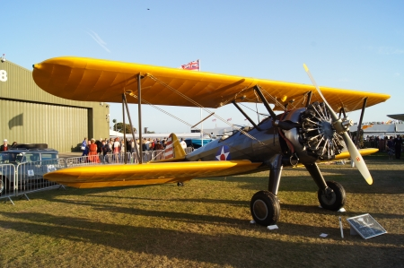 seater: WEST SUSSEX, ENGLAND. SEPTEMBER 2012: 1942 Boeing Stearman 75 plane at the Goodwood Revival festival on 15th September 2012; Goodwood, West Sussex, England Editorial