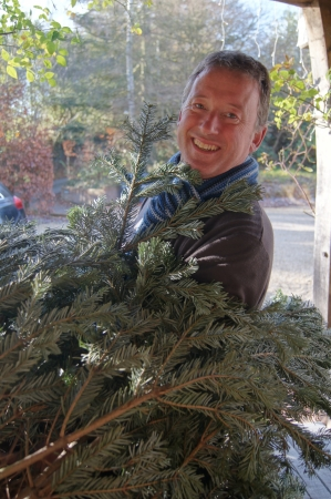 Man bringing home the Christmas tree for the family to decorate for the holidays Stock Photo - 16036328