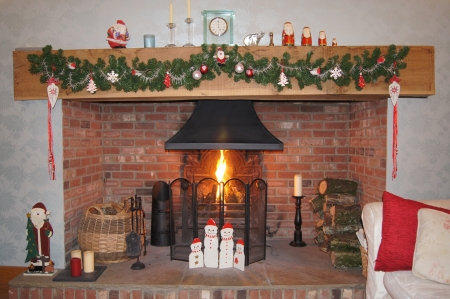 Cosy festive fireplace with garland and santa s and snowmen ornaments photo