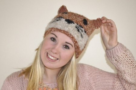 Girl wearing fun fox face hat photo
