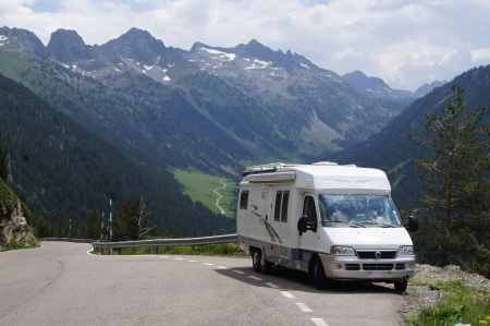 motorhome: Motorhome driving up a mountain range on vacation