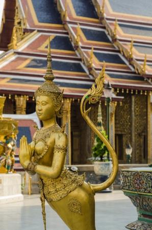 Beautiful golden Kinnari in Wat Phra Kaew, Bangkok, Thailand, Traditional Thai Temple Art