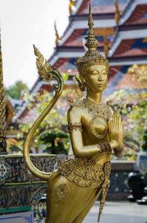 Beautiful golden Kinnari in Wat Phra Kaew, Bangkok, Thailand, Asian style Art photo