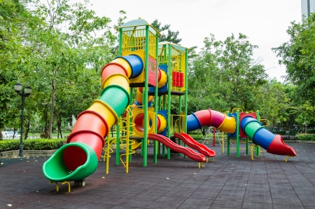 Modern colorful children playground in public park photo