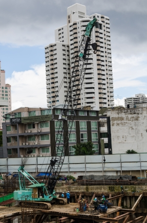poling: BANGKOK - OCTOBER 8 : Construction site with crane at Sukhumvit road on October 8, 2012 in Bangkok, Thailand.