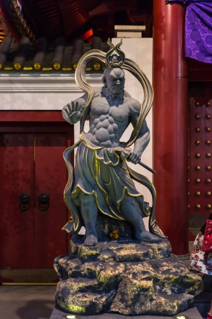 Guardian of the Buddha Tooth Relic Temple Door in China Town Singapore