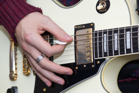 man playing guitar: a young man playing guitar Stock Photo