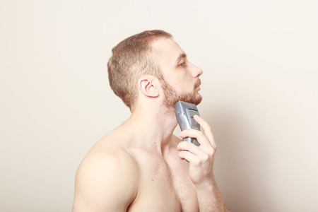 shave: bearded guy shave electric razor