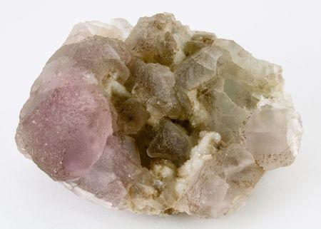 colored druse of quartz on the white photo