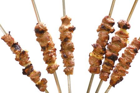 roasted shish kebab on skewers isolated on white