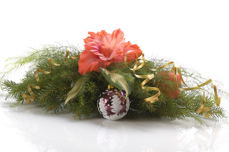 Chrismas composition with flower, gold ribbon, ball and branches of firtree isolated on white photo