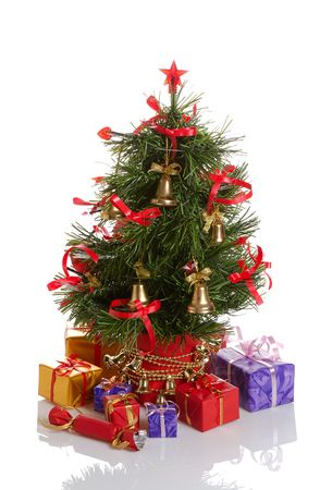decorated Christmas tree with gifts on white