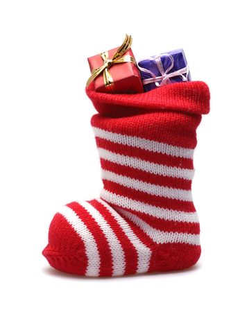 christmas stocking and gifts  isolated on white