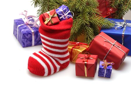 christmas stocking and gifts under christmas tree
