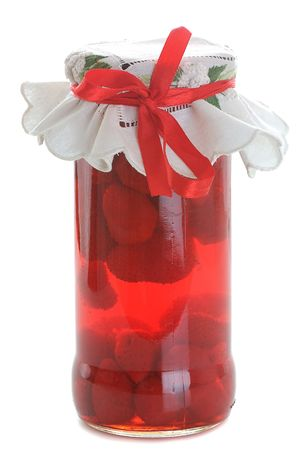 strawberry jar covered with embroidered napkin isolated on white photo