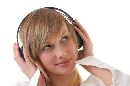 musik: blond girl  teenager with headphones listens to musik Stock Photo