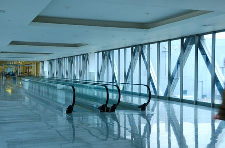 glass  blue corridor with moving stairs Stock Photo - 2885796