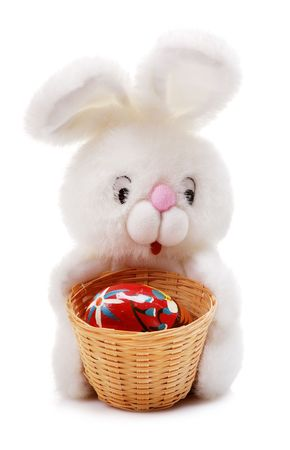 Easter rabbit holding basket with painted colorful easter egg photo