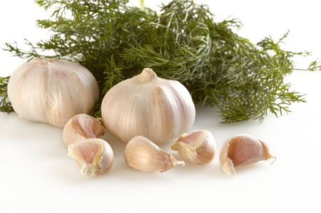 pungent: garlic with dill on white background Stock Photo
