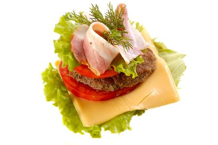 junkfood: big hamburger with slices of cheese, lettuce, bacon, beef,tomato, drill Stock Photo