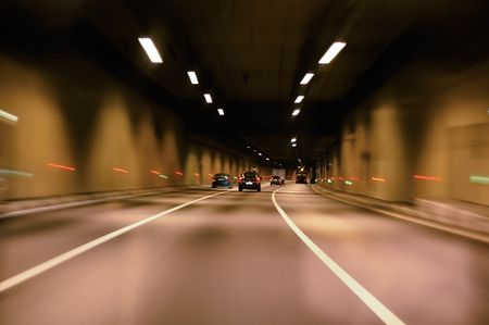 fast lane: highway tunnel at night Stock Photo
