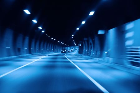 highway tunnel at night photo
