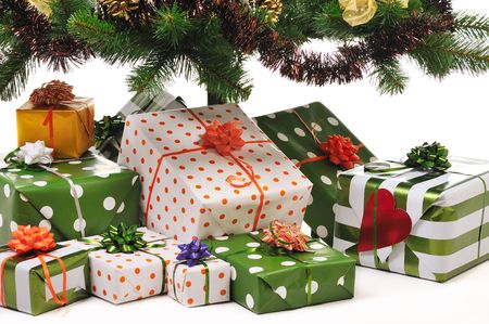 toygift: Christmas gifts under decorated fir tree